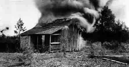 A burning cabin near Rosewood, FL, January 4, 1923.